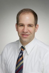 Dr. Adam Wilcox