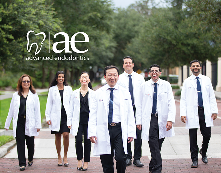 Six doctors walking down the street in their lab coats