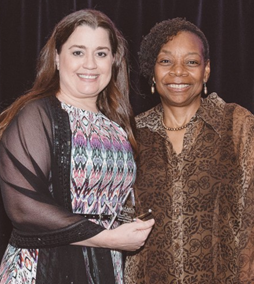 AAFCS 2017-18 President Jacqueline Holland, CFCS-HDFS, (right) presents Dawn Michaelson, (left) with the AAFCS Jewell L. Taylor Graduate Fellowship during the AAFCS 109th Annual Conference in Atlanta, Ga.