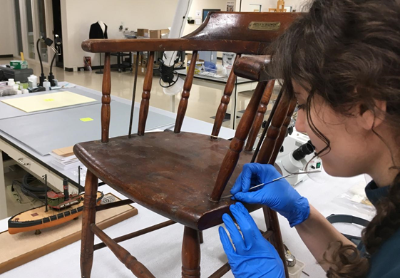 Paige Schmidt, treating 19th century pilot house chair (Courtesy of The Mariners' Museum and Park)