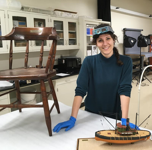 Paige Schmidt, with Pilot House chair and Lighter Model (Courtesy of The Mariners' Museum and Park)