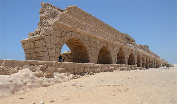 Ruins of the Roman aqueduct at Caesarea. The city became the capital of the Roman province of Judaea in 6 CE. Photo taken by author/contributor in June 2013.