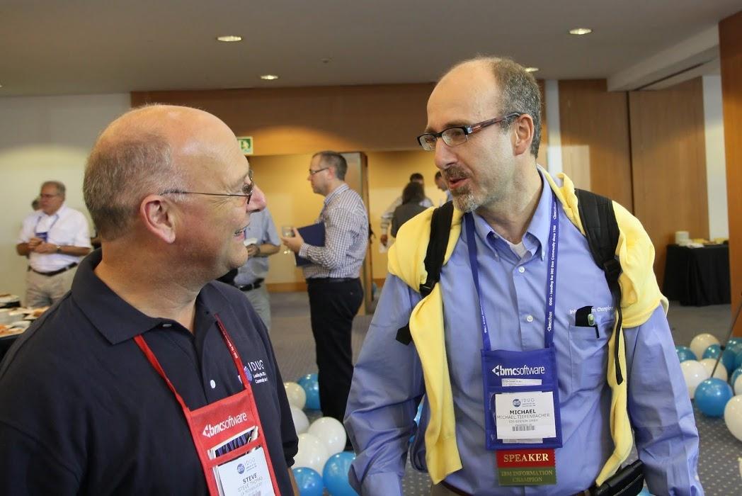 Steve Thomas and Michael Tiefenbacher enjoy a conversation at IDUG EMEA in Barcelona.JPG