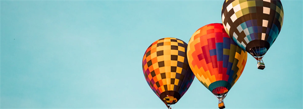 Three colorful hot air balloons in the sky