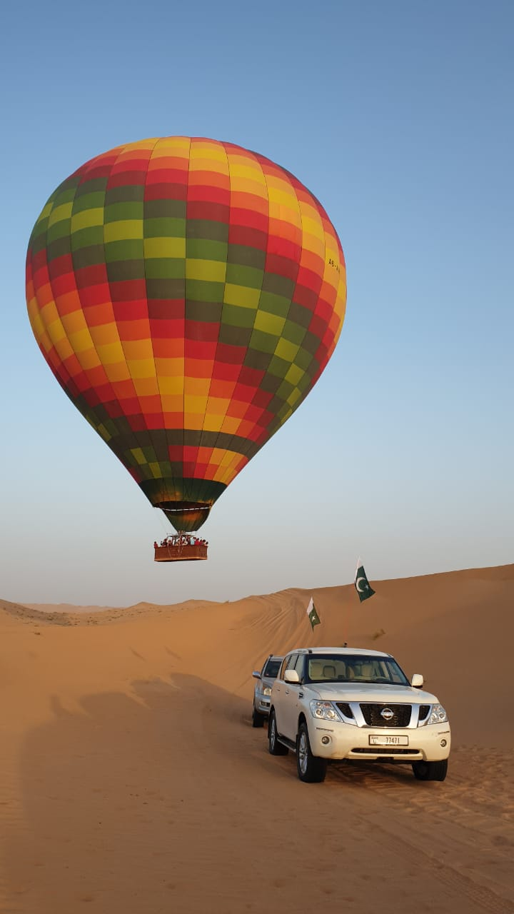 A hot air balloon passed by us at a very low altitude while we were driving in the desert