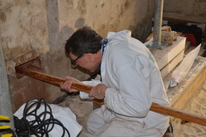 Craig Bennett inserting the camera into the space beneath the portico. | Credit: Drayton Hall Preservation Trust