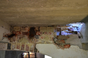 Figure 5: Exposed joist pockets in cellar below portico. | Credit: Drayton Hall