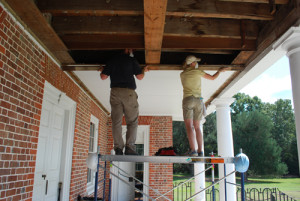 Figure 4: Drayton Hall preservation staff removing dropped ceiling from 1st floor of portico. | Credit: Drayton Hall