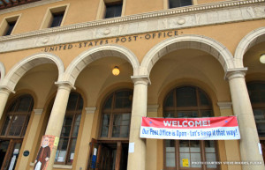 Signs in protest of privatizing the post office are displayed between the Italianate columns. | Credit: Steve Rhodes, Flickr