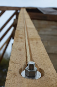 New Common rafter reinforced with 6mm Vectran12 braid low stretch line (vectran 12 data)  and stainless steel anchor bolts.  Only the bolt head will be visible.  Photo credit: | Sarah Jackson, National Center for Preservation Training and Technology