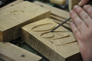 Student practicing hand carving lettering. | Credit: Savannah Technical College
