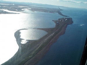 An aerial  view of the Alaskan Island of Kivalina at risk from flooding and erosion worsen by climate change. | Credit: U.S. Army Corps of Engineers Digital Visual Library (Via Wikipedia)