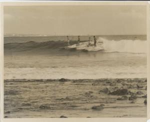 Enjoying Malibu Surfing, Los Angeles County/California: (l to r) Ricky Grigg, unknown, Vicki Williams, and Nick Gabaldón (ca, 1940–1950). Photography   Courtesy of Vicki Williams/Photo by Joe Quigg