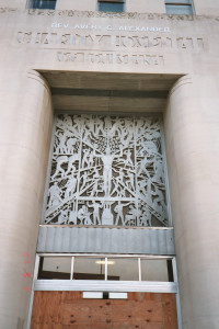 Charity Hospital main entrance with art deco lettering & relief | Credit: Carolyn Bennett