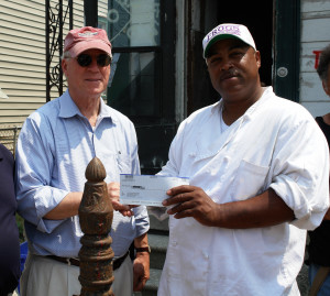 Richard Moe presents a check to David MacGraw, who works as a cook at Gallatoire's, a famous restaurant in the French Quarter. Mr. MacGraw's specialty is crawfish etouffé. | Credit: Preservation Resource Center