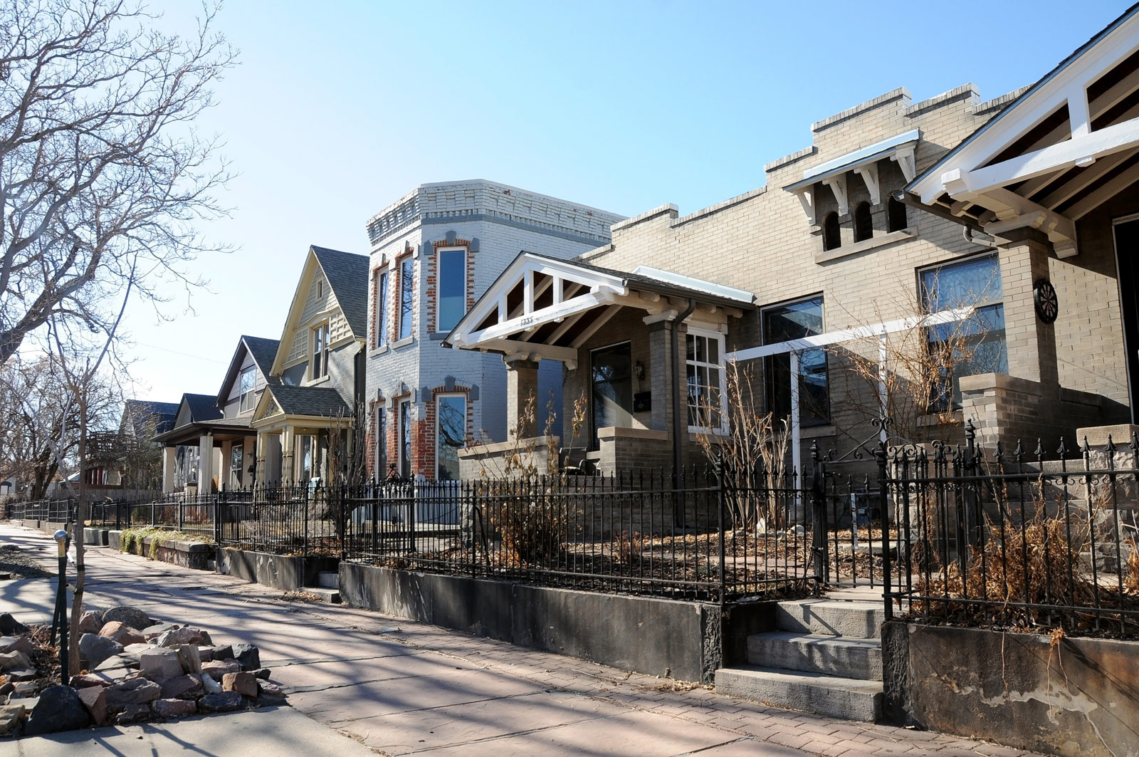 Neighborhood streetscape showing the variety of architectural styles along Lipan street in Denver.