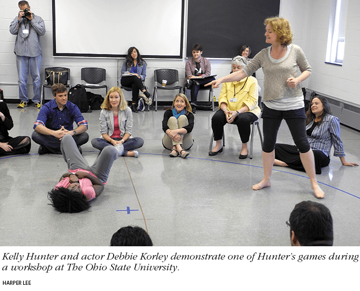 Photo: Kelly Hunter and actor Debbie Korley demonstrate one of Hunter's games during a workshop at The Ohio State University. Photo by Harper Lee.