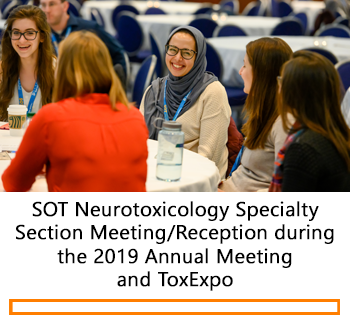Individuals smiling during the Neurotoxicology Specialty Section reception
