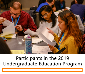 Students reading a case study during the 2019 Undergraduate Education Program