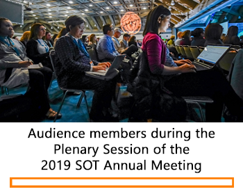 Audience members looking at their laptops during the Plenary Session of the 2019 SOT Annual Meeting