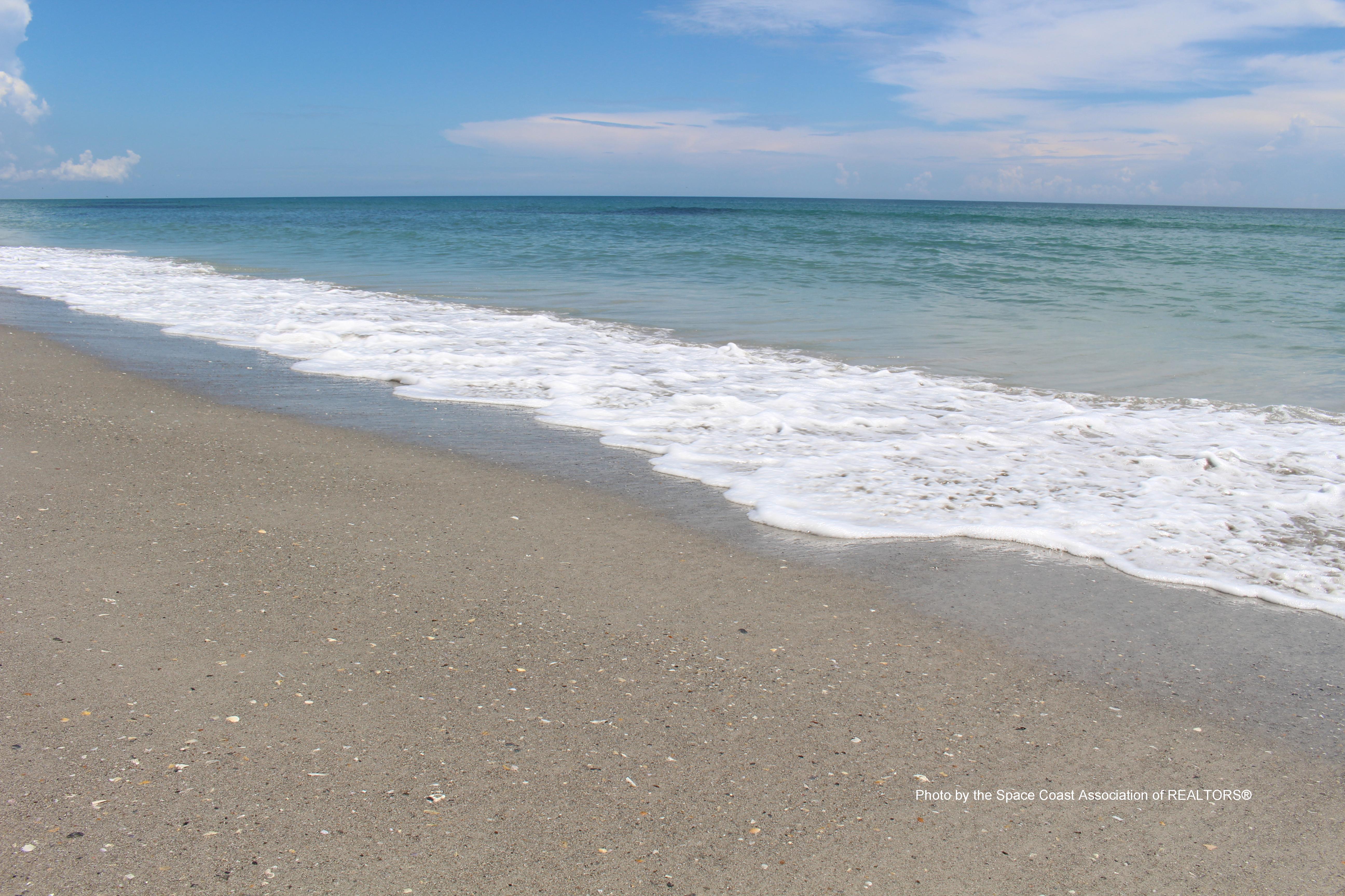Waves washing up on Indialantic beach, Florida