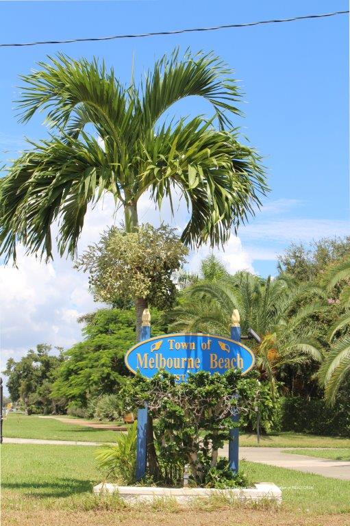 Town of Melbounre Beach, Florida blue sign with palm tree